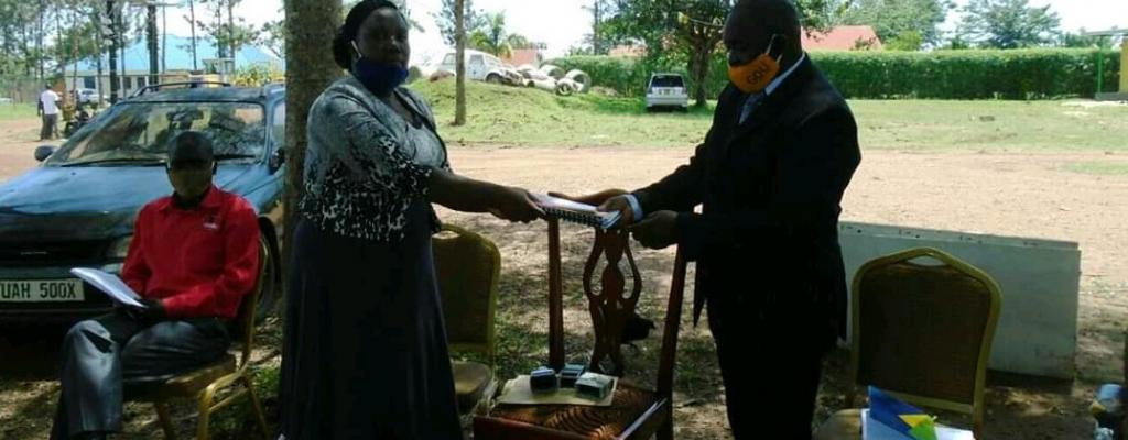Outgoing Ag. CAO Moses Agum handover office to the new incoming CAO Ms.Edith Namayega
