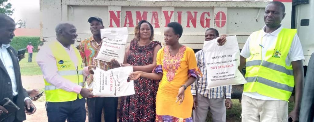 Woman MP donating maize flour to the District task force